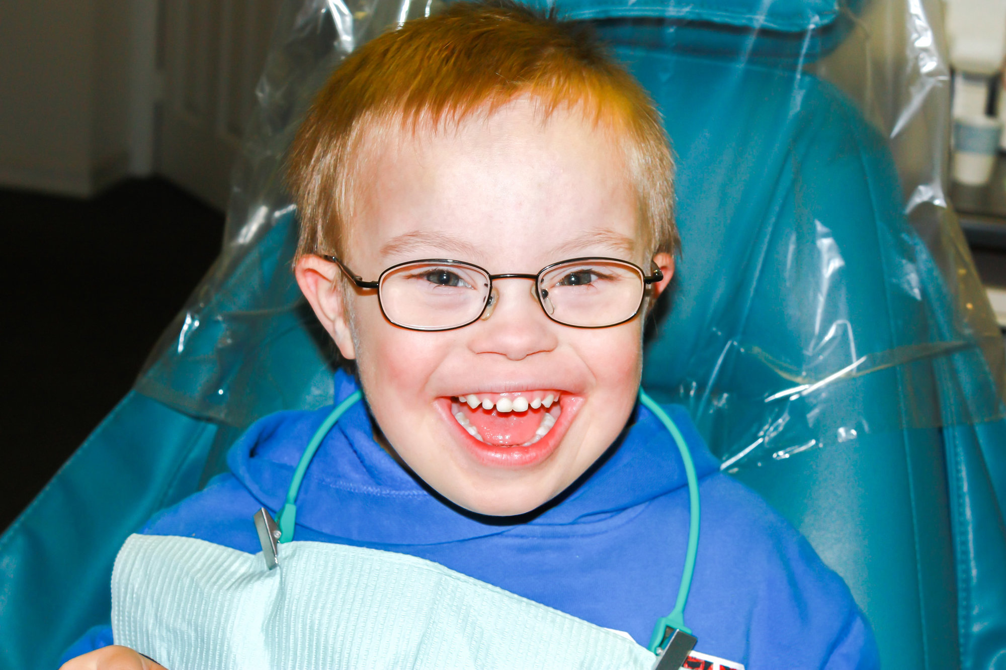 picture of a boy with down syndrome in a dentist chair